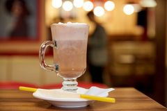 Milk shake with straws on a wooden table in a cafe. Milk shake with straws on a wooden table in cafe stock photos