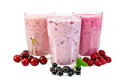 Milk shakes with berries in glass Royalty Free Stock Photos