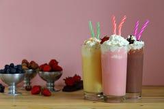 Free Milk Shakes With Strawberries Vanilla And Chocolate Stock Photography - 117709702