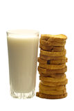 Milk and sliced bread. A glass of fresh milk and sliced bread Stock Photo