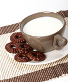 Milk and small chocolate biscuits Stock Photography