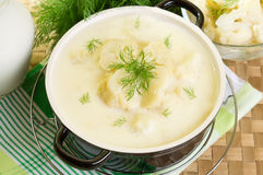 Milk soup with cauliflower. Garnished with dill Stock Photography