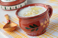 Milk soup with noodles in cup Royalty Free Stock Images