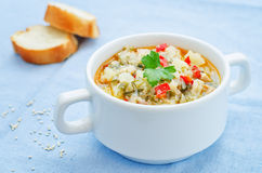 Milk soup with potatoes, quinoa and peppers Royalty Free Stock Images