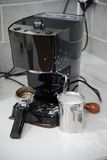 Milk spattered espresso machine Royalty Free Stock Photos