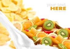 Milk splash with fruit mix on corn flakes Stock Image