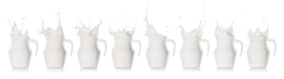 Milk splash in a glass jug stock photos