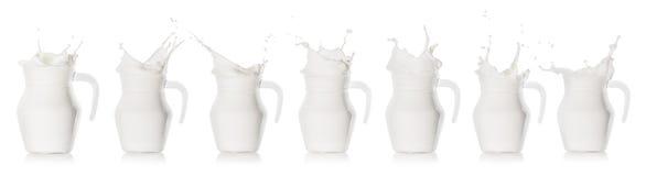 Milk splash in glass jug royalty free stock photo