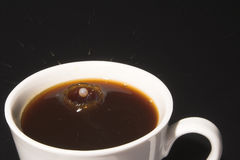 Milk Splash in Hot Coffee Stock Photos