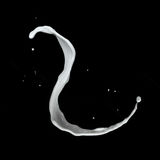 Milk splash isolated on black Royalty Free Stock Images