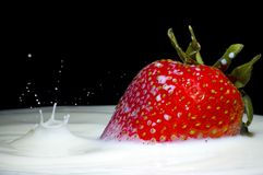 Milk splash and strawberry Stock Photography