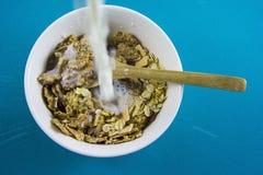 Milk splashing into bowl of cereals Royalty Free Stock Photo