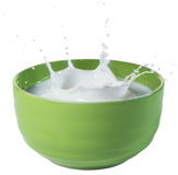 Milk Splashing in Green Bowl Stock Photos