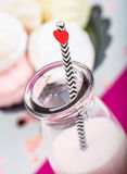 Milk with a straw with hearts Stock Photography