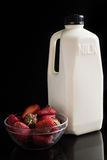Milk and strawbery on the black Royalty Free Stock Images