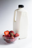 Milk and strawbery on the white Stock Photography