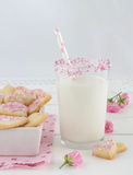 Milk with sugar sprinkles and cookie hearts Royalty Free Stock Photography