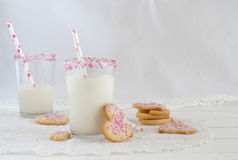 Milk with sugar sprinkles and cookie hearts Stock Photos