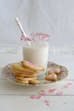 Milk with sugar sprinkles and cookie hearts Stock Photo