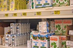 Milk on supermarket shelves Stock Photo
