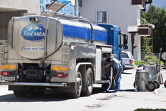 Milk tanker in Anras, Pustertaler Valley, Austria. A farmer has dropped a pair of milk churns along the street in Anras, a village in the Austrian Pustertaler Royalty Free Stock Photography