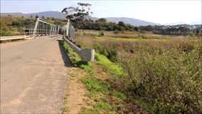 Milk tanker crossing a rural bridge stock video