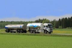 Milk Tanker Truck on Scenic Summer Road. FORSSA, FINLAND - APRIL 19, 2014: Volvo FM tanker truck transporting Valio milk. The ca. 100 Finnish Valio milk trucks Stock Photography