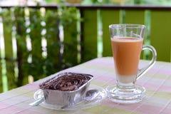 Milk tea and cake. Milk tea and chocolate banoffee cake Royalty Free Stock Photo