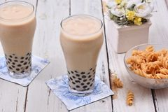 Milk tea with pearls. On wooden table royalty free stock photos