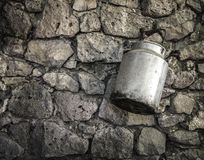 Milk tin hanging from the wall Royalty Free Stock Image