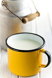 Milk in tin mug Royalty Free Stock Image