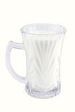 Milk in transparent glass Royalty Free Stock Image
