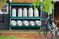 Milk and typical bike in a Dutch village (Zaandam) Stock Photography