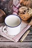 Milk in a vintage can and cookies Royalty Free Stock Images