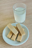 Milk and wafer. The milk and the wafer is a healthy breakfast.Comfortable to prepare Royalty Free Stock Photos