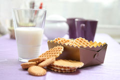 Milk with waffles on table. Milk in glass with waffles on table royalty free stock images