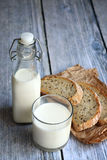 Milk and wholegrain bread Stock Images