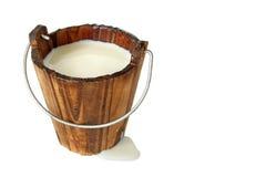Milk in wooden bucket. Wooden bucket filled with fresh milk isolated Stock Photos