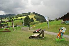 Milka Line en Saalbach, una pista del paseo para la familia entera, en las montañas de Kohlmais Imagen de archivo libre de regalías
