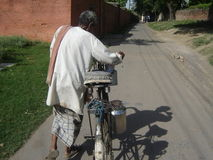 Milkman. The Milkman selling milk on a street of allahabad India stock images