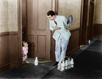 Milkman greeting baby at door Stock Photos