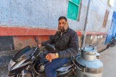 Milkman in Jodhpur. Jodhpur, India,17th January 2017 - A milk man on a motobike in Jodhpur, India Royalty Free Stock Image