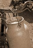 Milkman old bicycle with can of milk and ancient sepia toned royalty free stock photo