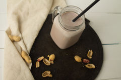 Milkshake шоколада на белой предпосылке Стоковое Фото
