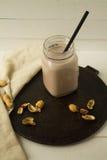 Milkshake шоколада на белой предпосылке Стоковые Изображения