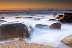Milkshake. Milky waves and Rocky shore beach of Umhlanga near Durban Royalty Free Stock Photo