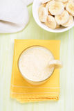 Milkshake with banana in glass Stock Images