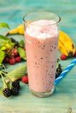 Milkshake with banana, raspberries blackberries and blackcurrants. Fresh milkshake with banana, raspberries blackberries and blackcurrants Royalty Free Stock Photos