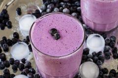 Milkshake with berries Stock Images