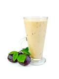 Milkshake with black plums Royalty Free Stock Photography